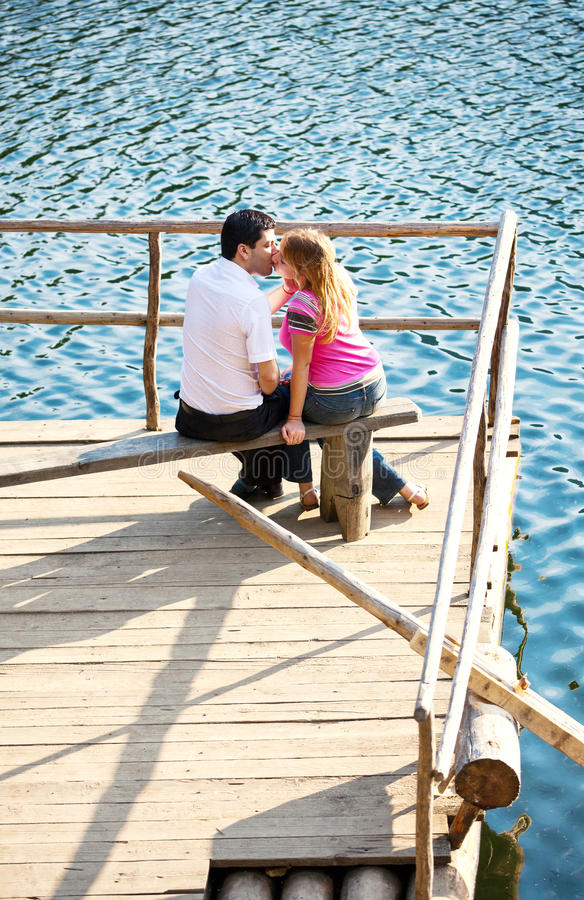 Young couple on the lake stock photography