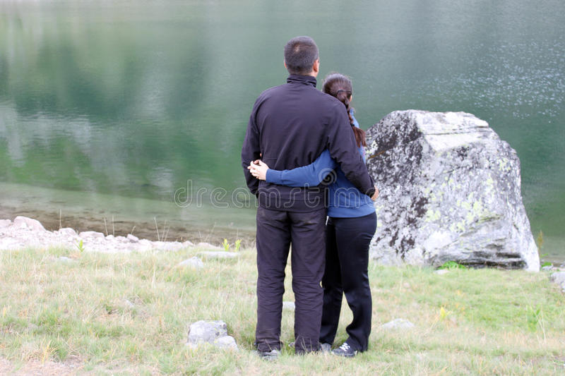Young Couple by a Lake royalty free stock photos