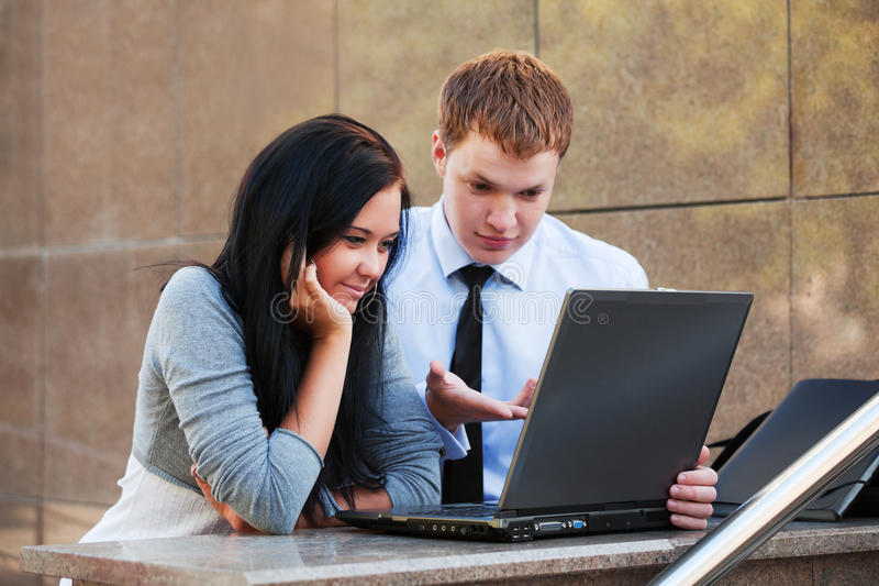 Young couple with laptop. royalty free stock images