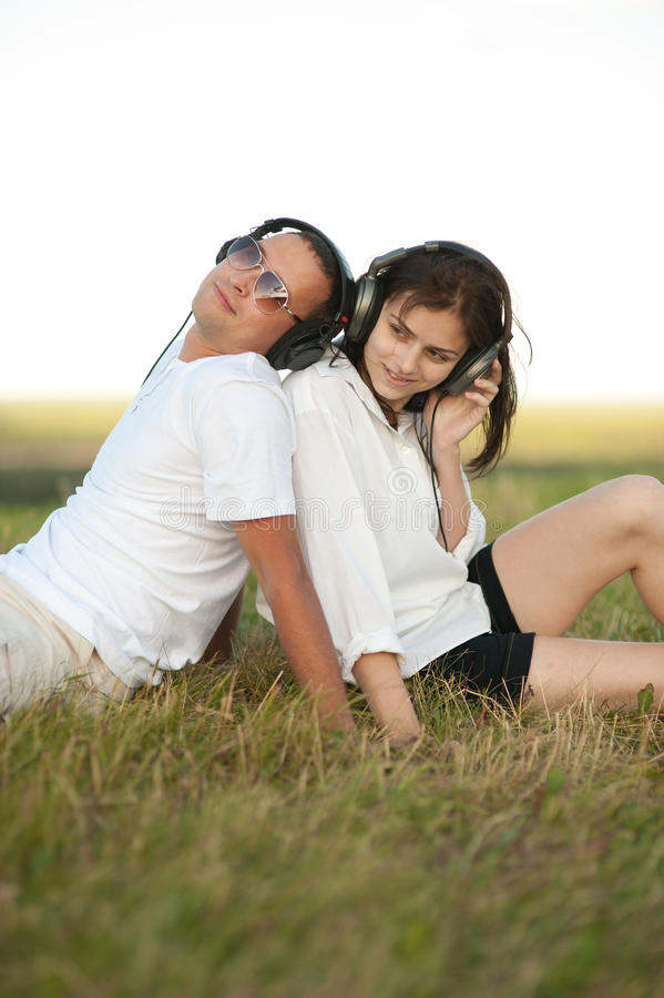 Young couple listening to music stock photography