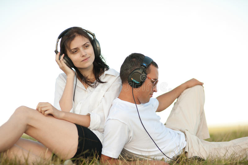 Young couple listening to music royalty free stock image