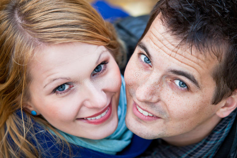 Download Young Couple Looking At Camera Stock Image - Image of beauty, forest: 24658061