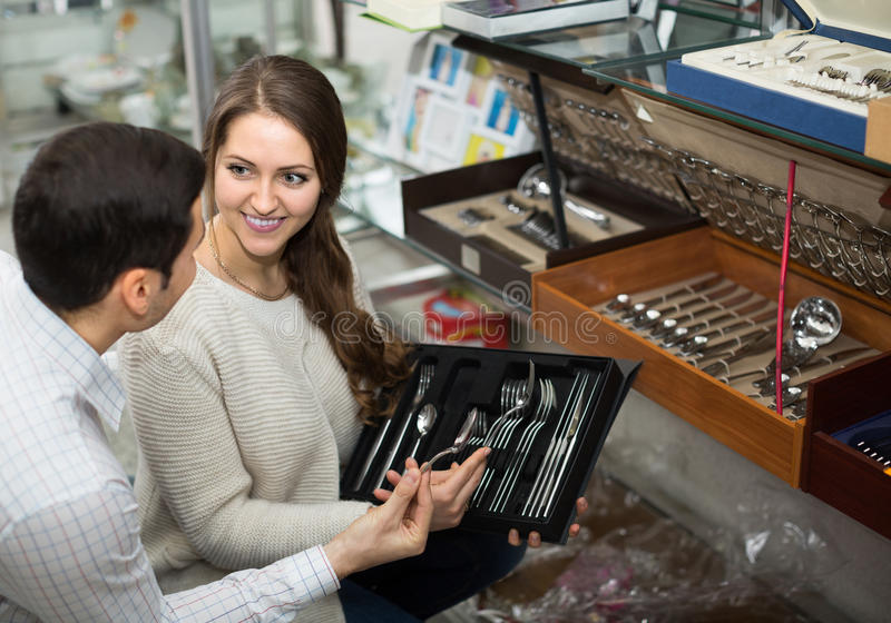 Young couple looking at cutlery royalty free stock images