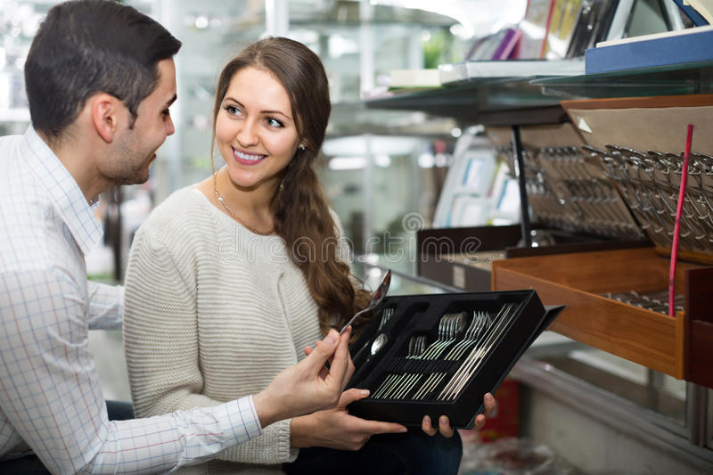 Young couple looking at cutlery royalty free stock photos