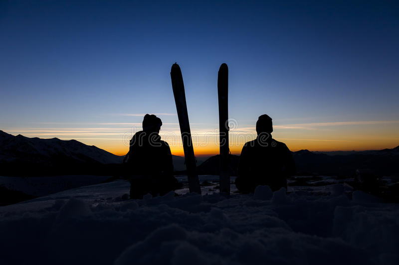Young couple looking at the mountain sunset stock photography