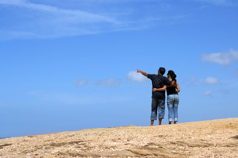 Download Young Couple Looking Up Together Stock Photo - Image: 1831174