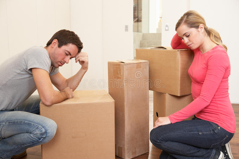 Download Young Couple Looking Upset Among Boxes Stock Image - Image: 18044685
