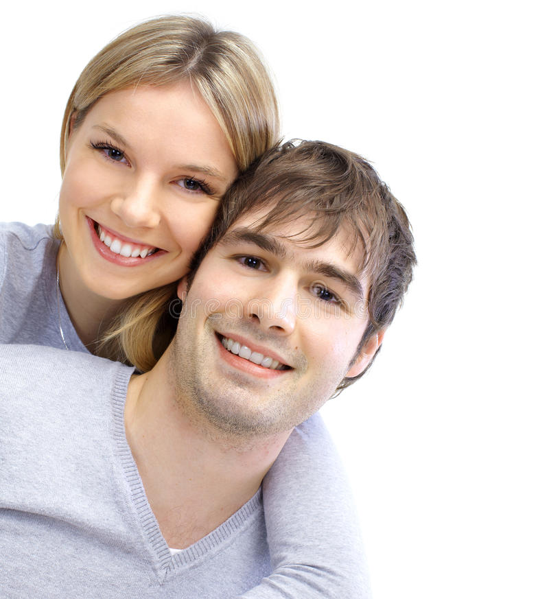 Young couple in love. Happy smiling couple in love. Over white background royalty free stock photo