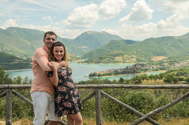 Young couple in love on a background of a mountain lake Lago del Turano stock photo