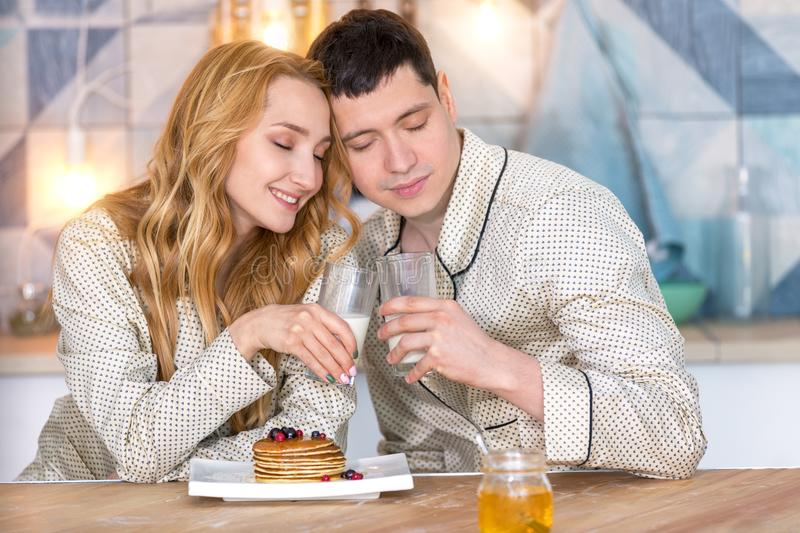 Young couple in love during Breakfast. Happy young couple early in the morning in her apartment. Family life stock photography