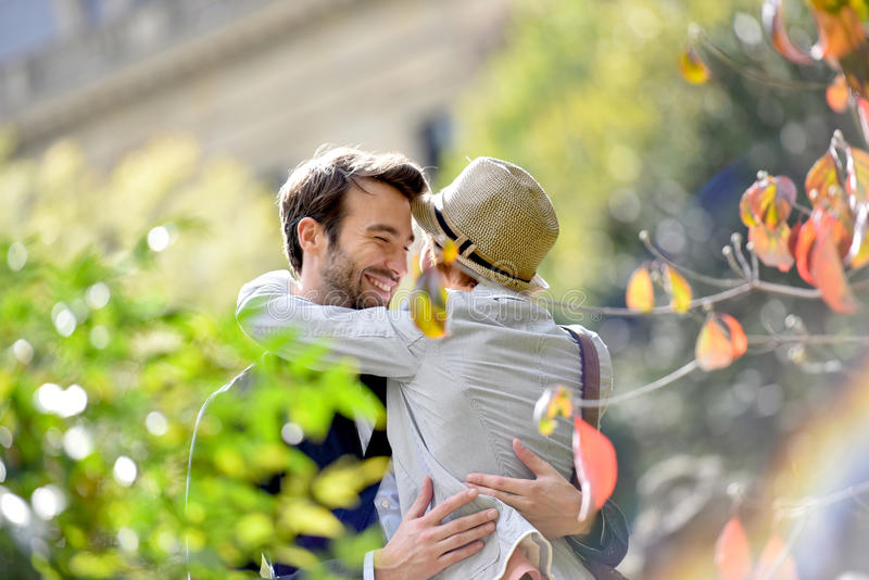 Young couple in love embracing in park royalty free stock photo