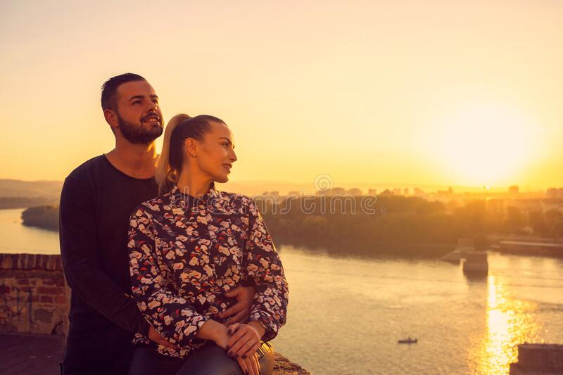 Young  Couple in love, enjoying at the romantic moment at sunset royalty free stock photography