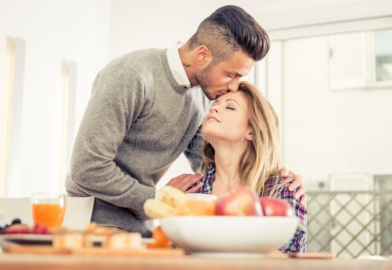 Young couple in love having breakfast at home. stock photo