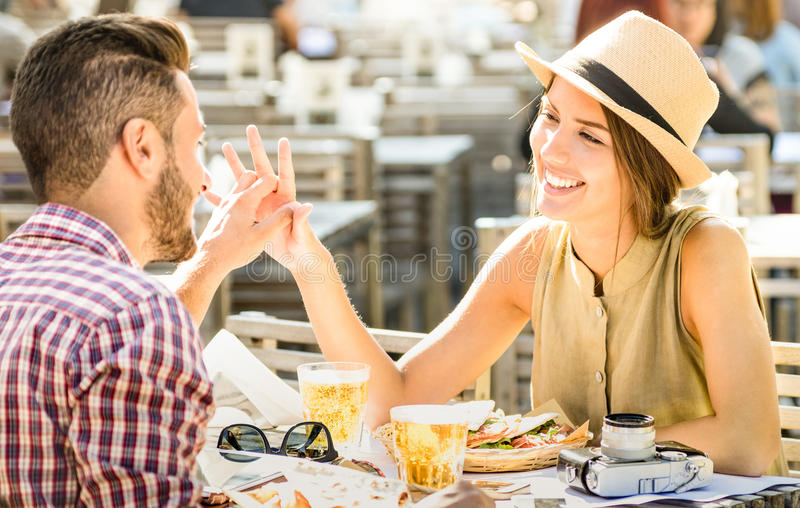 Young couple in love having fun at beer bar on travel excursion royalty free stock photography