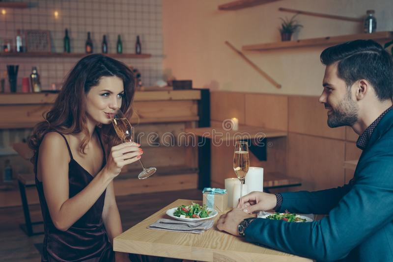 young couple in love having romantic dinner together royalty free stock photos