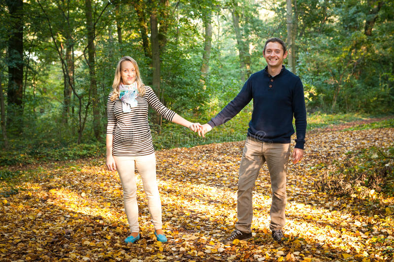 Young couple in love holding hands royalty free stock photography