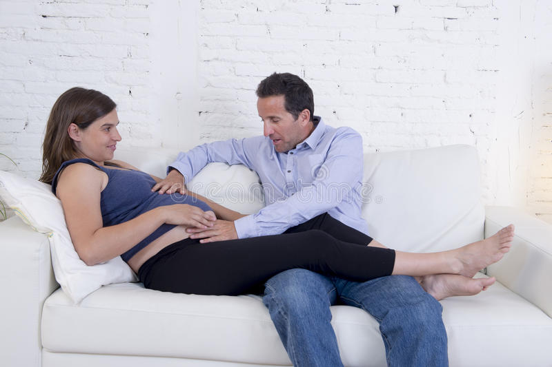Young couple in love at home living room couch with the woman be royalty free stock photos