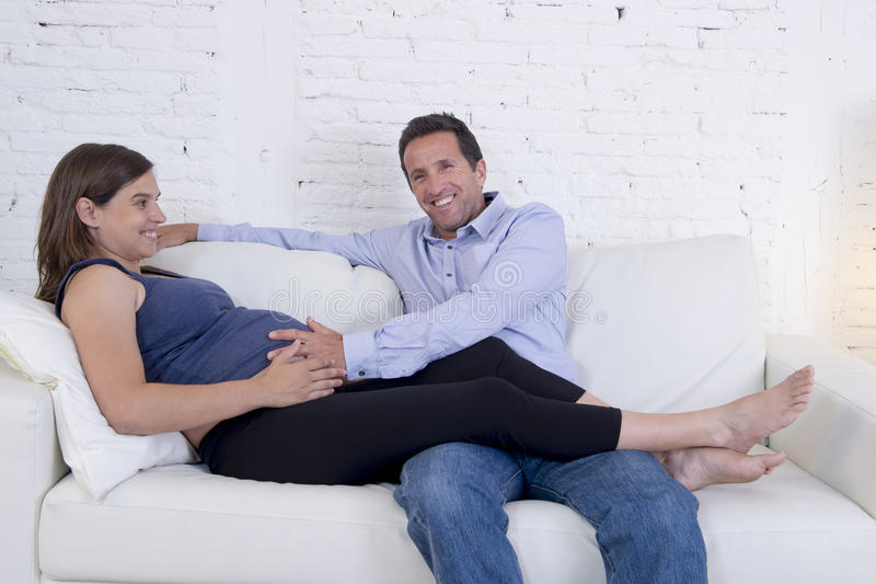 Young couple in love at home living room couch with the woman be royalty free stock photography