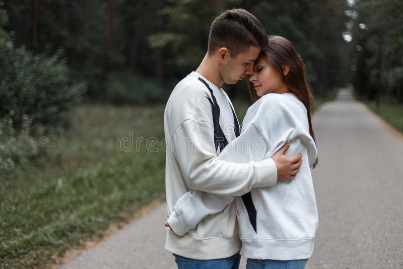 Young couple in love hug each other on the nature background. stock photography