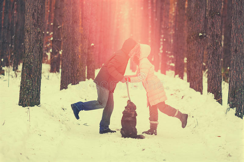 Young couple in love kissing outdoor in winter at sunset royalty free stock photography