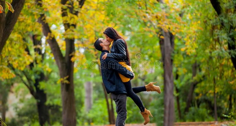 Young couple in love kissing stock photos