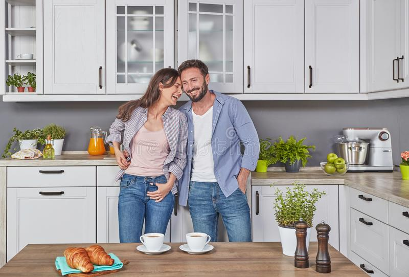 Happy couple in the kitchen stock photos