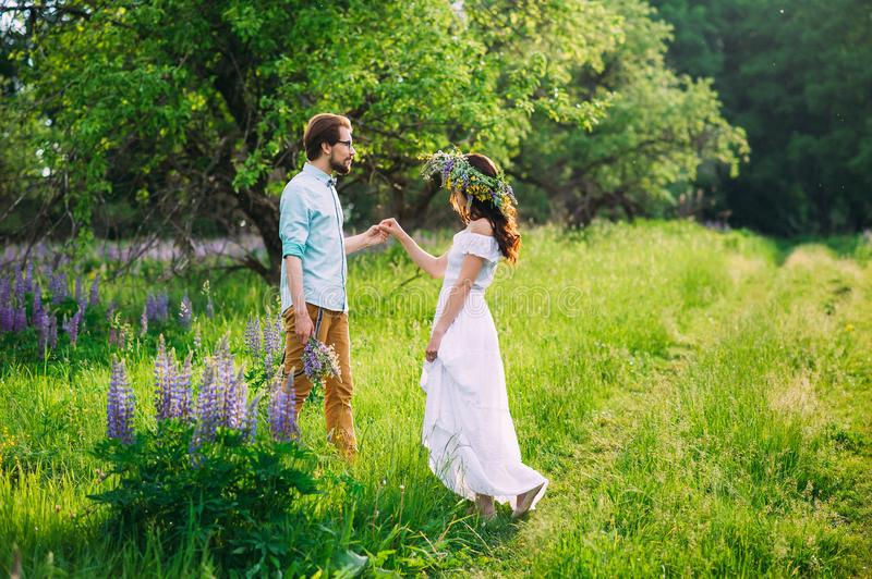Young couple in love on meadow royalty free stock photography