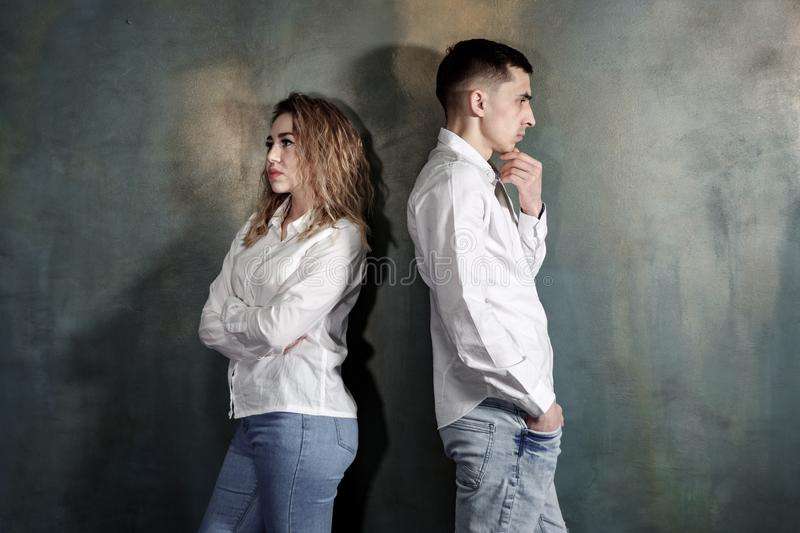 Young couple in love are offended at each other and no one wants to put up. stock photography