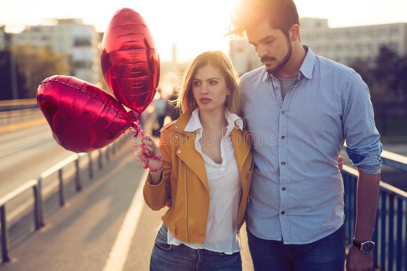 Young couple in love outdoor -serious fashion concept royalty free stock image