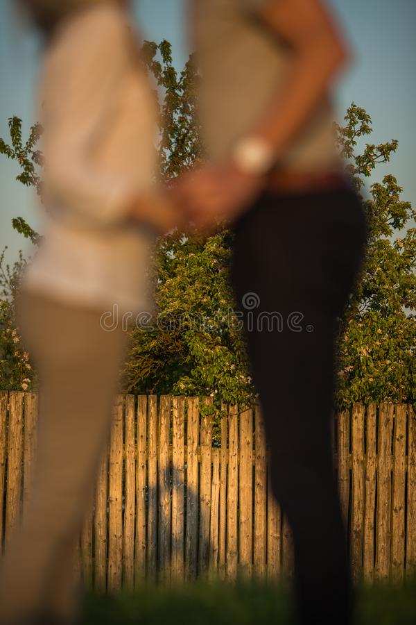 Young couple in love outdoors casting a lovely shadow royalty free stock photography