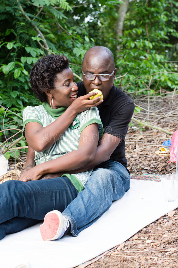 Download Young Couple In Love At A Picnic. Stock Photo - Image: 83723026