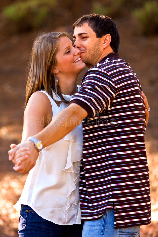 Download Young Couple In Love Pretend To Dance In Park Stock Photo - Image of park, love: 25265192