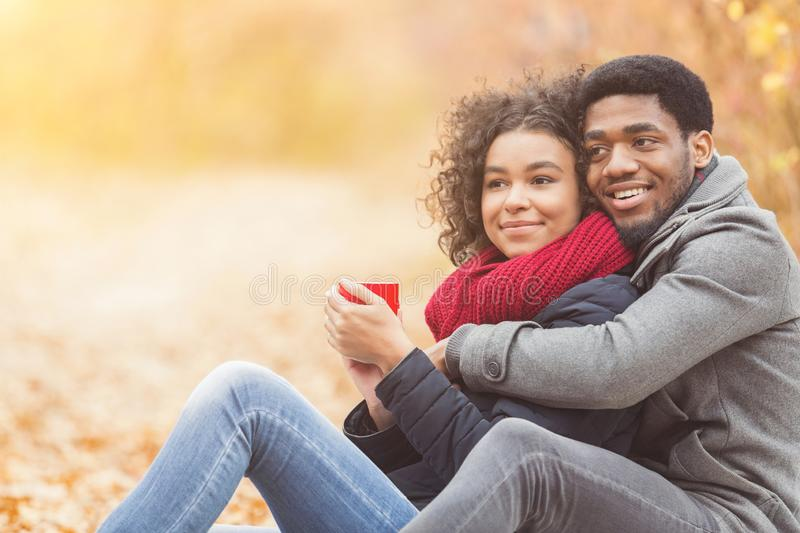 Young couple in love spending time together at park royalty free stock photo