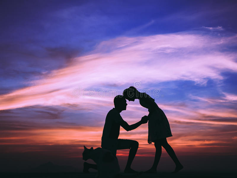 Young Couple love at sunset. Silhouette of Happy Young Couple love Outside at Sunset stock photos