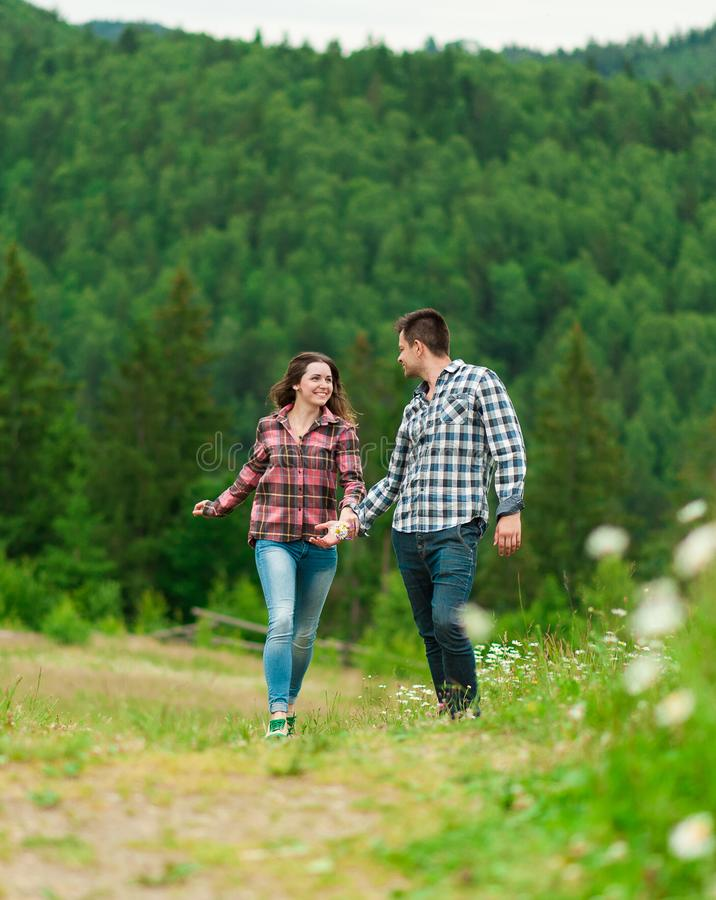 Young couple in love walking in mountain. Loving couple having fun on summer vacation. Young couple in love walking in mountain.Portrait of a happy couple stock photos