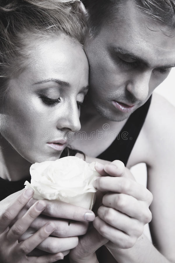Download Young Couple In Love With A White Rose Stock Photo - Image: 26198806