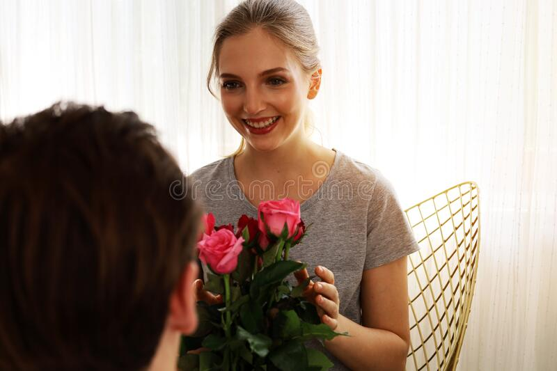 Young couple lover surprise give rose flower in valentine`s day. Young couple lover happy surprise give rose flower in valentine`s day stock photography