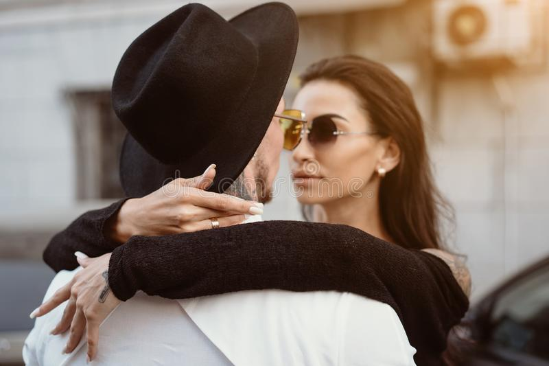 A young, couple of lovers pose for a camera on the streets stock images