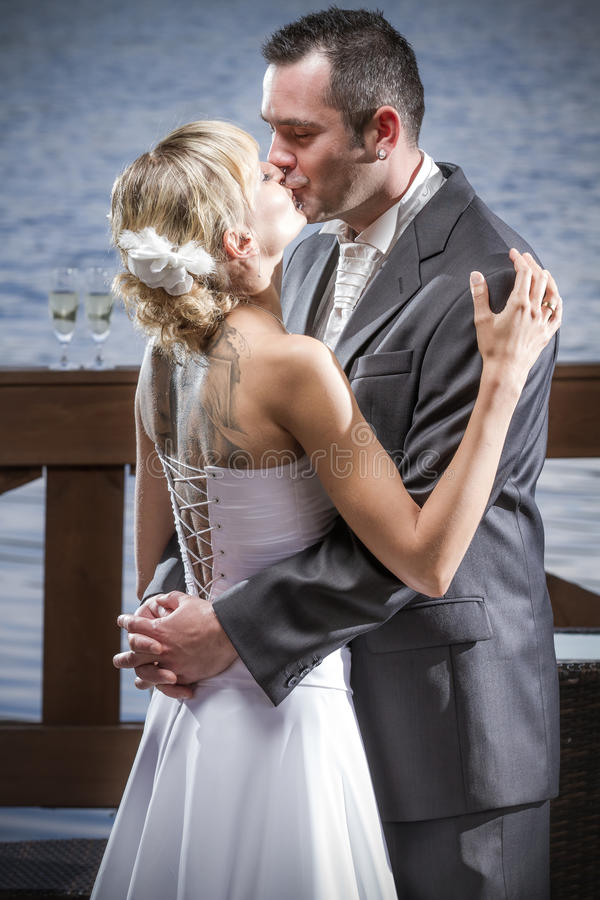 Young couple in a loving hug stock images