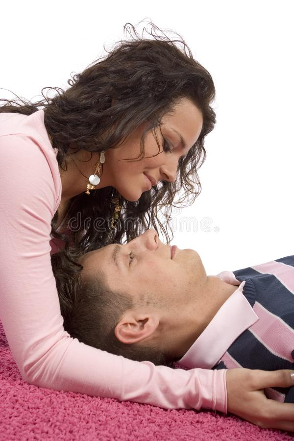 Young couple lying on the pink carpet stock photos