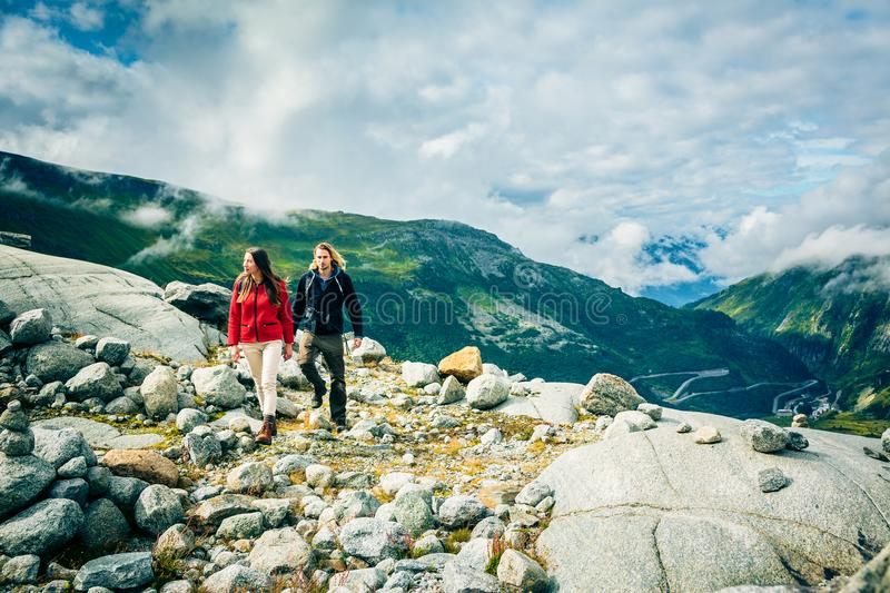 Young Couple Hiking In The Swiss Alps stock image