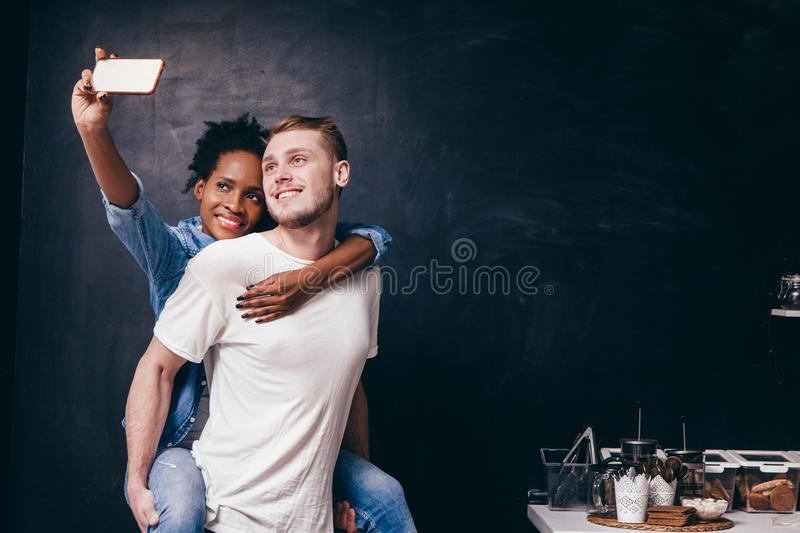 Young couple make selfie on kitchen, live together stock photos