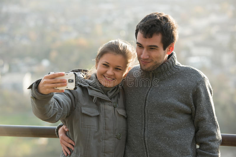 Young couple makes selfie stock photo