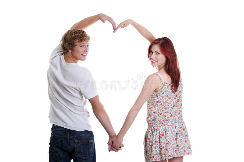 Young couple making heart shape. stock photography