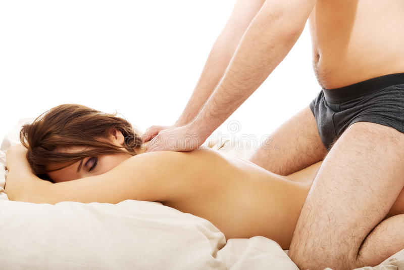 Young couple making massage at home. royalty free stock photos