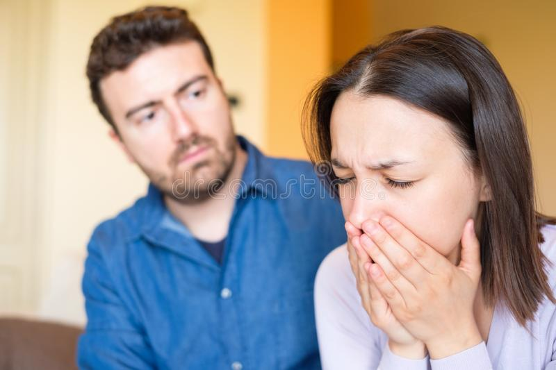 Young couple making peace after arguing at home royalty free stock photography
