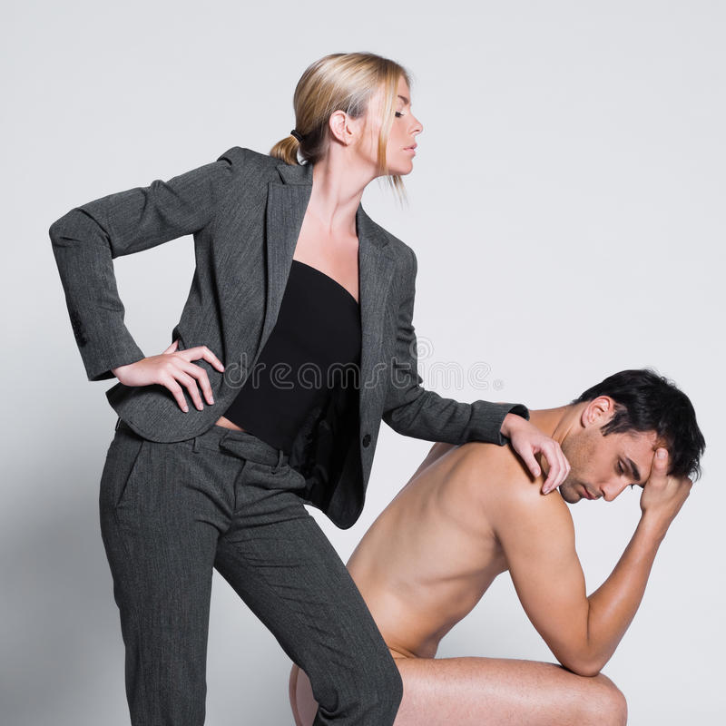 Young couple with man naked. Young couple with men naked in studio on isolated grey background royalty free stock photography