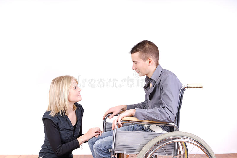 Young couple with man in wheelchair stock photo