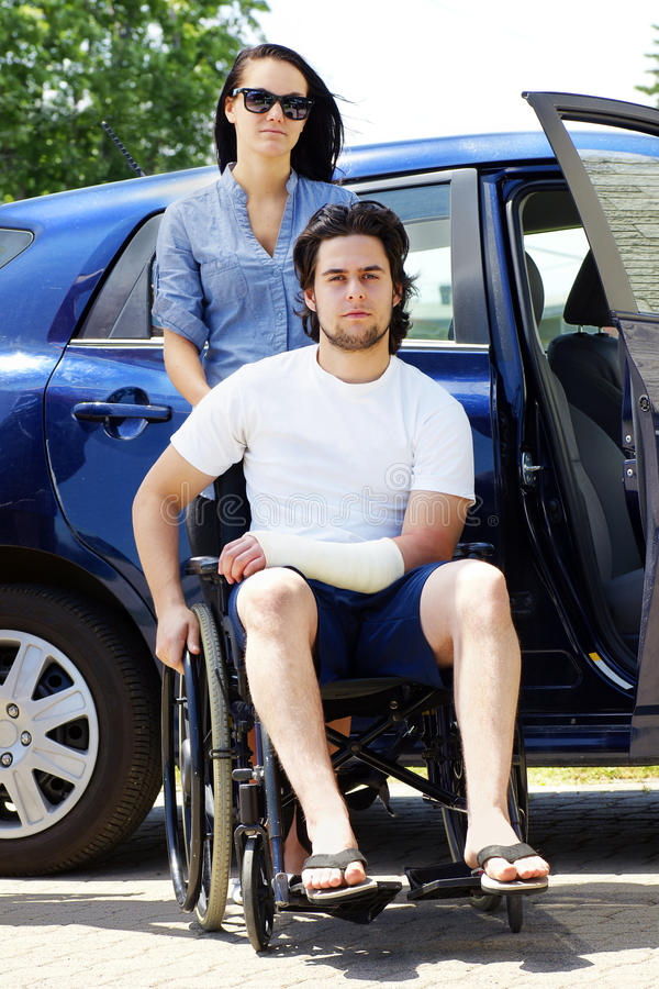Young couple with man in wheelchair stock photos