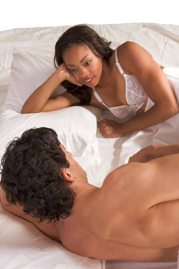 Young Couple Man And Woman Talking In Bed Stock Image